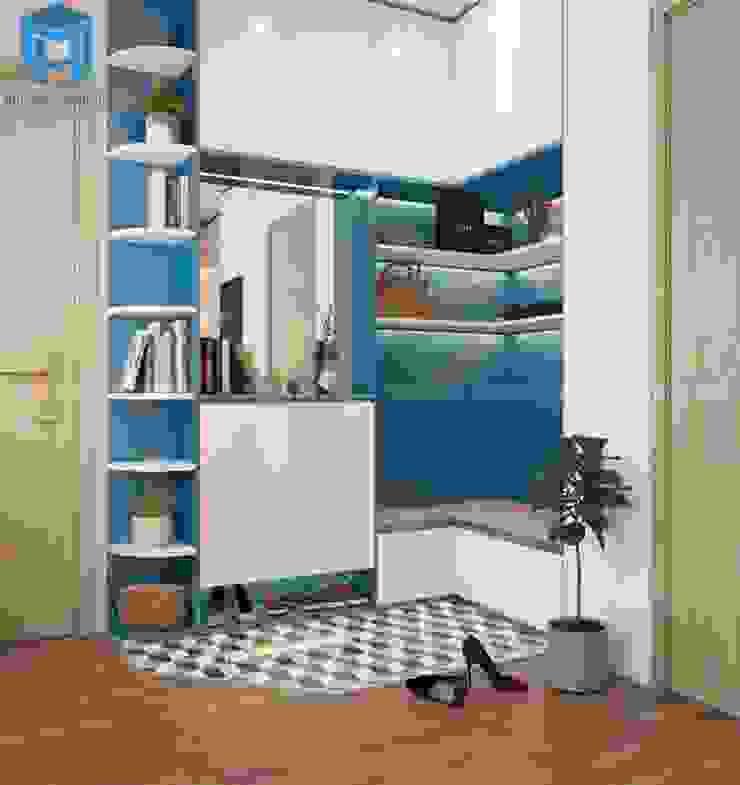 Hệ thống tủ giày chung với tủ chứa đồ và kệ gỗ bởi Công ty TNHH Nội Thất Mạnh Hệ Hiện đại