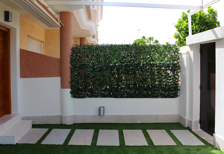 Jardín delantero reformado de homify Moderno