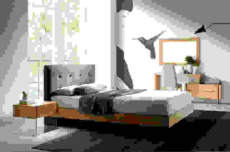 Dormitorio moderno con cabecero tapizado de la colección Atelier by Angel Cerdá de ANGEL CERDA Moderno Madera Acabado en madera