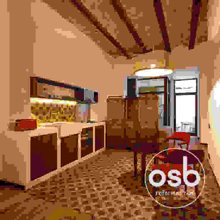 cocina abierta de osb arquitectos Rústico