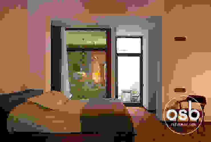 dormitorio abierto de osb arquitectos Rústico