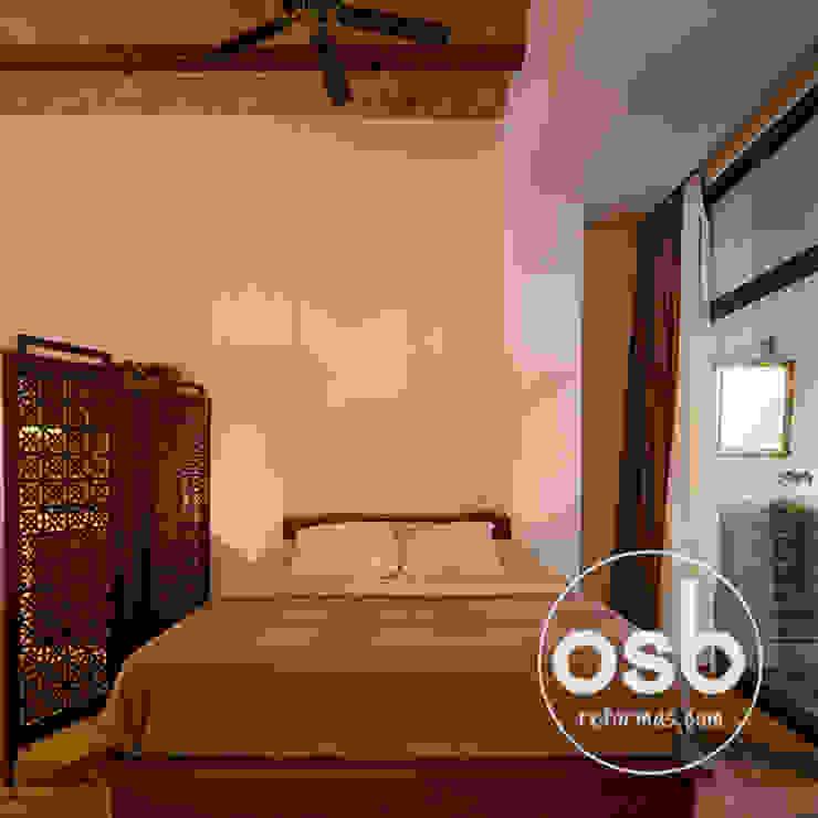 dormitorio de osb arquitectos Rústico