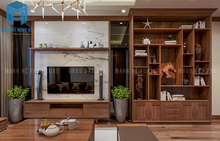 Phòng khách với hệ thống tủ tivi cùng tủ sách khá hữu ích bởi Công ty TNHH Nội Thất Mạnh Hệ Hiện đại