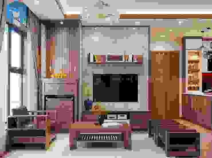 tủ tivi được đặt ngay bên cạnh tủ thờ trong không gian phòng khách bởi Công ty TNHH Nội Thất Mạnh Hệ Hiện đại