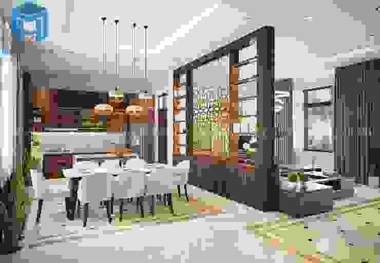 Không gian phòng bếp và phòng khách được phân chia bởi vách ngăn bằng gỗ khá đẹp Phòng ăn phong cách hiện đại bởi Công ty TNHH Nội Thất Mạnh Hệ Hiện đại