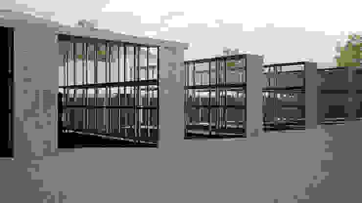 Riqualificazione funzionale ed ampliamento showroom materiali edilizi Simone Fratta Architetto Spazi commerciali moderni Ferro / Acciaio Metallizzato/Argento