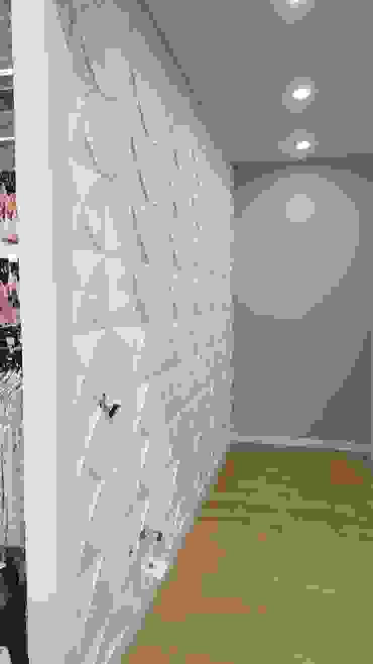 Suministro e Instalación PANEL 3D FIBRA VEGETAL - EXITO COUNTRY Bogotá de TITAN DECKO Moderno