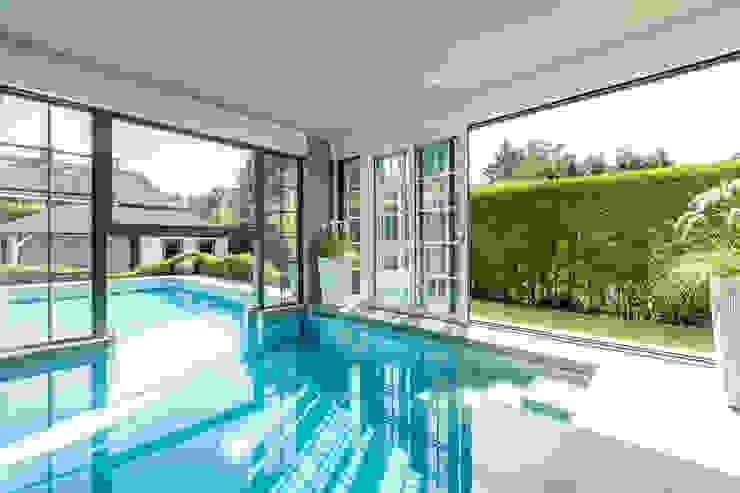 PROJECT VVG - UITBREIDING VILLA MET BINNEN-BUITENZWEMBAD TE EDEGEM Landelijke zwembaden van ICONcept Landelijk