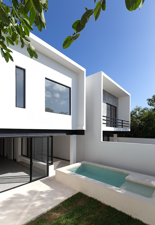 fachadas posteriores Daniel Cota Arquitectura | Despacho de arquitectos | Cancún Casas pequeñas Concreto Blanco