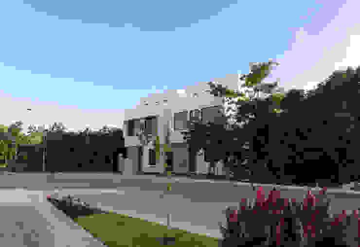 fachada principal Daniel Cota Arquitectura | Despacho de arquitectos | Cancún Casas pequeñas Concreto Blanco