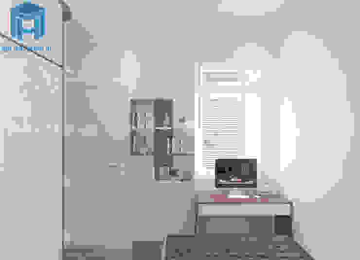 Bàn học cùng kệ sách treo tường được thiết kế khá kết nối với nhau bởi Công ty TNHH Nội Thất Mạnh Hệ Hiện đại