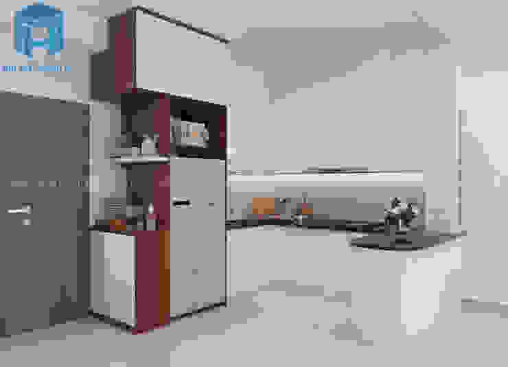tủ bếp màu trắng tạo cho gai chủ cảm giác sạch sẽ và tinh tế đến từng chi tiết Phòng ăn phong cách hiện đại bởi Công ty TNHH Nội Thất Mạnh Hệ Hiện đại