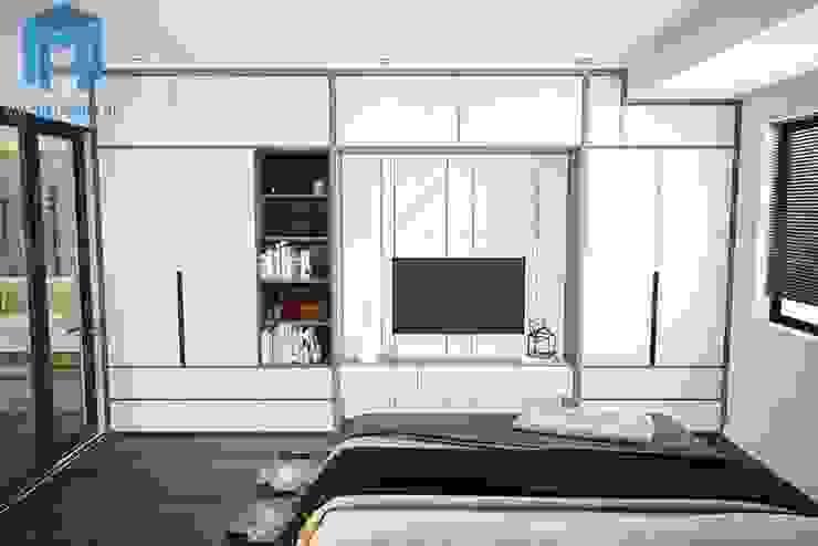 Hệ thống tủ quần áo, tủ tivi gắn kết với nhau Phòng ngủ phong cách hiện đại bởi Công ty TNHH Nội Thất Mạnh Hệ Hiện đại