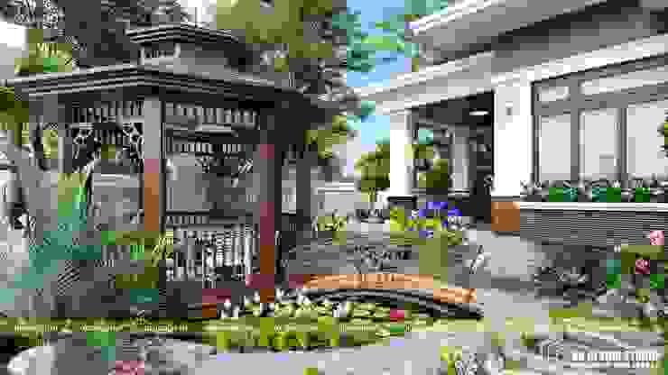Sân vườn biệt thự bởi UK DESIGN STUDIO - KIẾN TRÚC UK Nhiệt đới