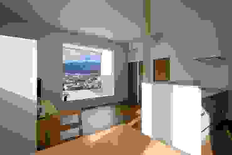 Minimalist dining room by N.A.O Minimalist