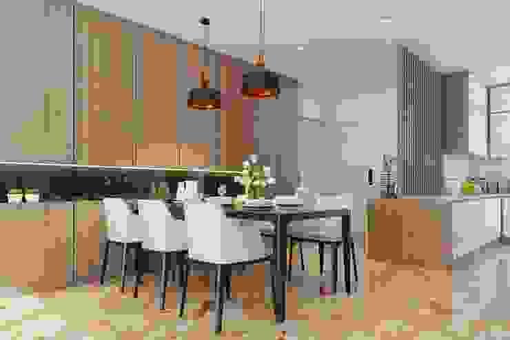 bộ bàn ăn được đặt ngay bên cạnh phòng khách Phòng ăn phong cách hiện đại bởi Công ty TNHH Nội Thất Mạnh Hệ Hiện đại