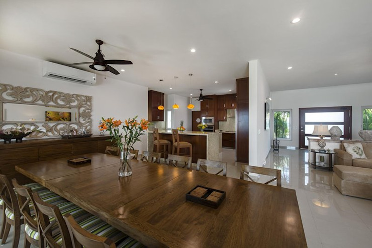 Casa fortuna Tropical style dining room by AC Construcciones Tropical