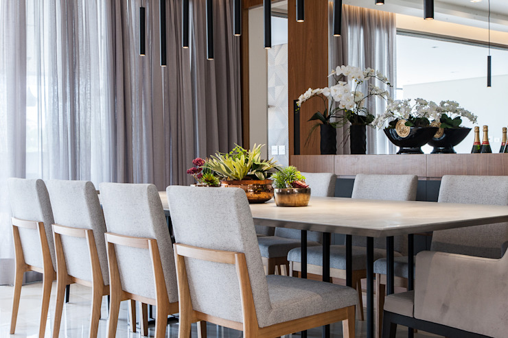 Modern Dining Room by Infinity Spaces Modern