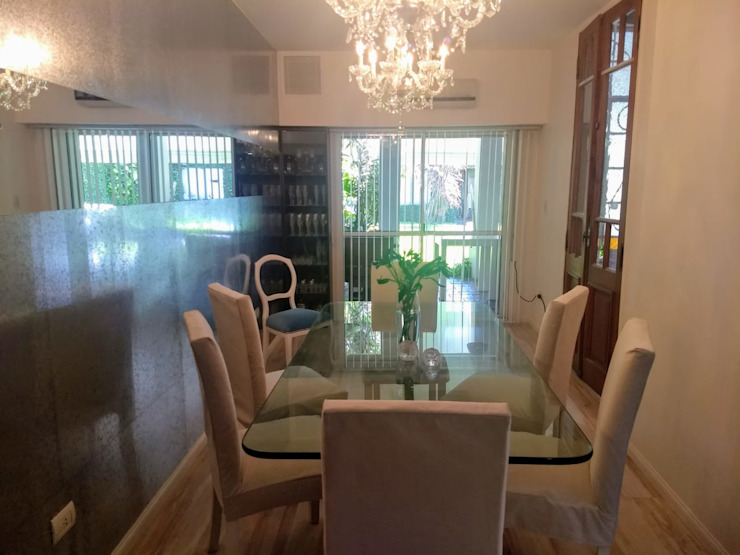 Comedor en una casa cnorizo Comedores de estilo ecléctico de Arquimundo 3g - Diseño de Interiores - Ciudad de Buenos Aires Ecléctico