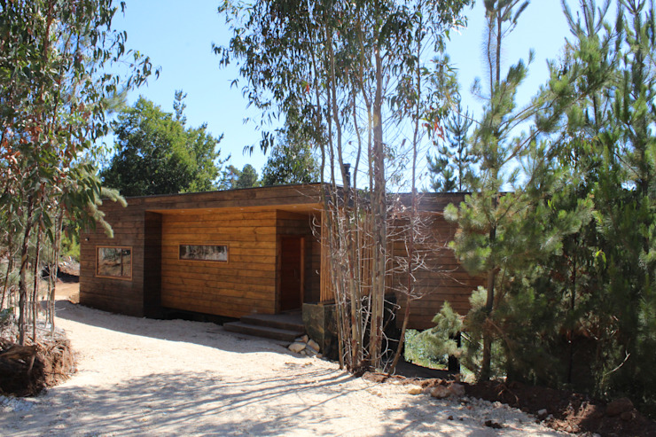 VIVIENDA EN FUNDO MILLACO de Kimche Arquitectos Mediterráneo Madera Acabado en madera