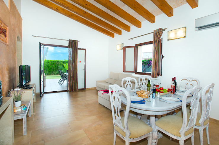 Diseño y construcción de una villa en Mallorca Comedores de estilo rural de Diego Cuttone, arquitectos en Mallorca Rural