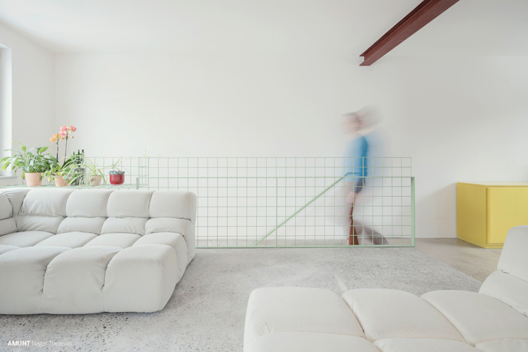 Living room by AMUNT Architekten in Stuttgart und Aachen, Minimalist Concrete
