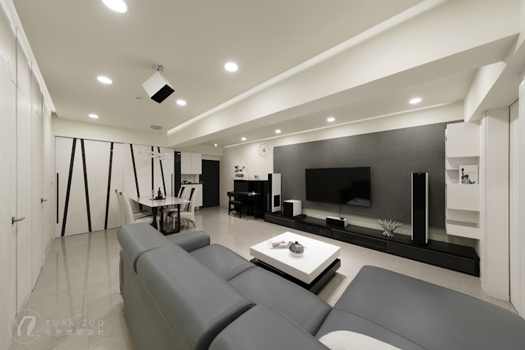 Paredes y pisos modernos de 元作空間設計 Moderno