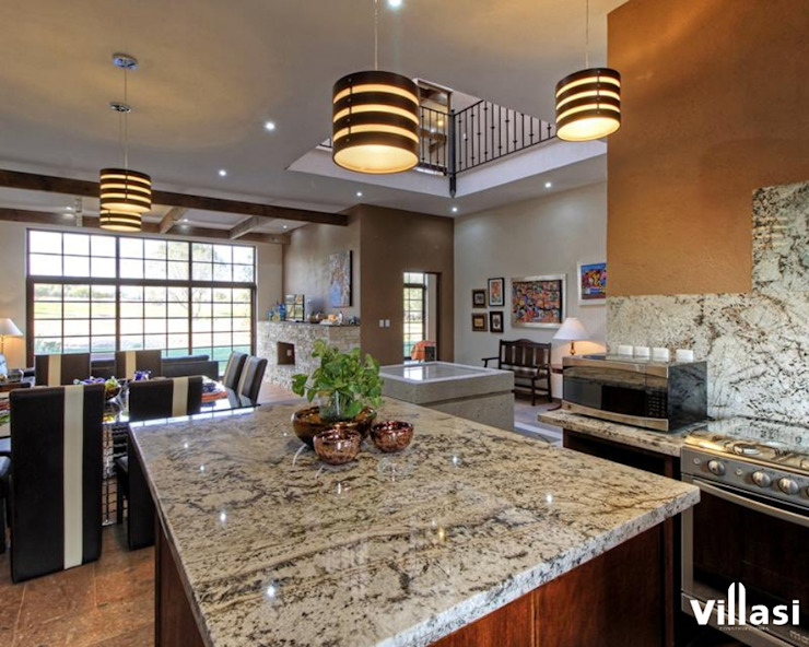 Rustic style kitchen by VillaSi Construcciones Rustic