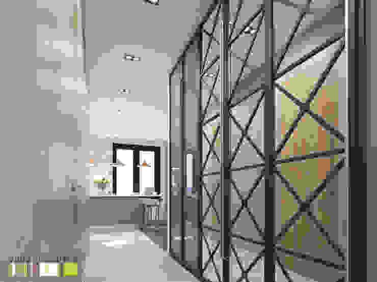 Pasillos, vestíbulos y escaleras de estilo ecléctico de Мастерская интерьера Юлии Шевелевой Ecléctico