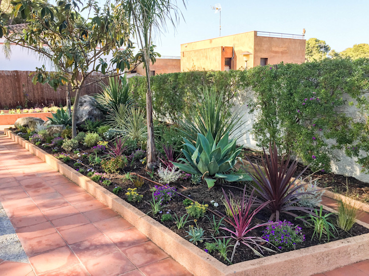 Parterre central Nosaltres Toquem Fusta S.L. Jardines de estilo tropical