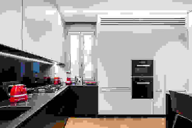 Reforma integral de un piso clásico en Madrid Cocinas de estilo clásico de AGi architects arquitectos y diseñadores en Madrid Clásico