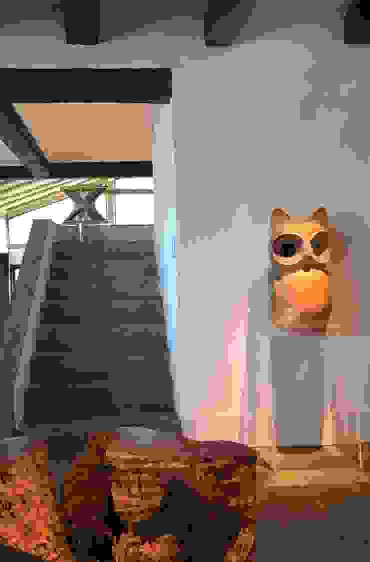 Cristina Szabo Designer de Bem-Estar Vestíbulos, pasillos y escalerasAccesorios y decoración Piedra