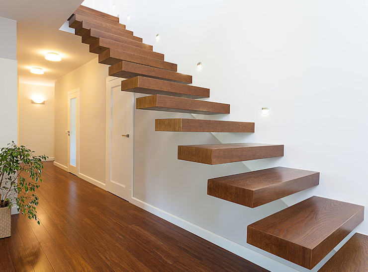 Floating staircases:  Stairs by Renov8 CONSTRUCTION