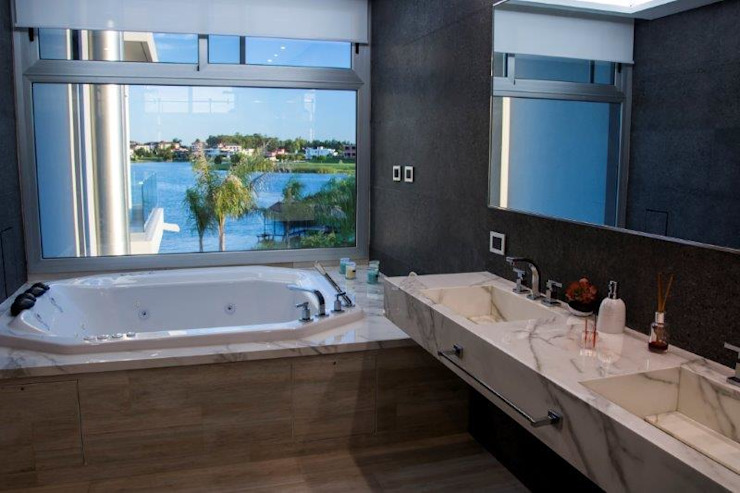 Casa La Reserva Cardales: Baños de estilo  por ARQCONS Arquitectura & Construcción