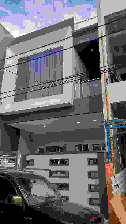 rumah poris (tangerang) Rumah Minimalis Oleh qic arsitek Minimalis