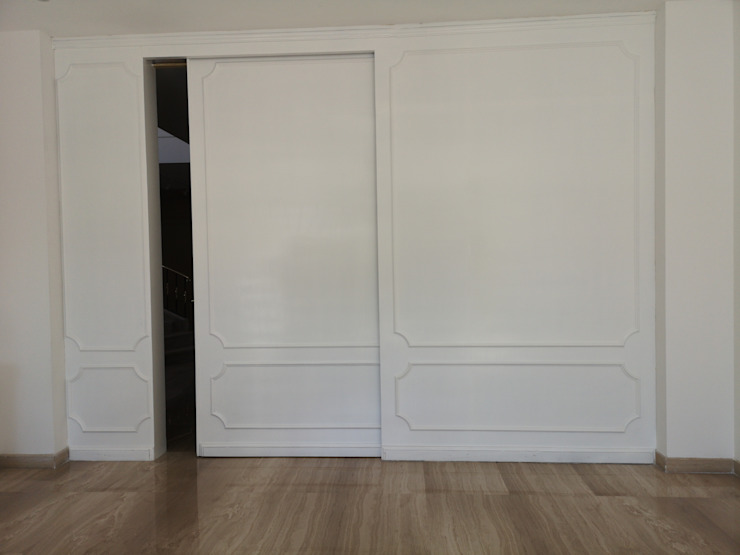 Fabricación de lambrín de madera Paredes y pisos de estilo clásico de doblev.arq Clásico