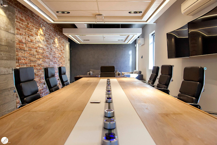 Boardroom by DMV INTERIOR DESIGN Modern Bricks