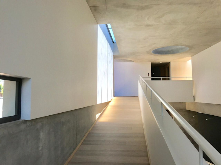 The Changeling Modern Corridor, Hallway and Staircase by PWM Architects Modern