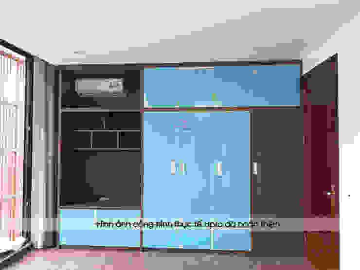 Ảnh thực tế tủ quần áo có kệ tivi trong phòng ngủ của bé nhà anh Phương tại Thanh Hóa: hiện đại  by Nội thất Hpro, Hiện đại