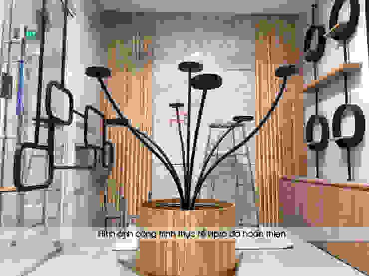 Ảnh thực tế kệ trưng bày mỹ phẩm gỗ laminate trong showroom: công nghiệp  by Nội thất Hpro, Công nghiệp
