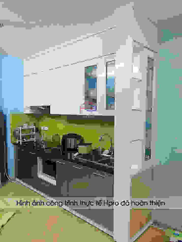Hoàn thành thi công tủ bếp acrylic kèm vách ngăn nhà anh Điệp: hiện đại  by Nội thất Hpro, Hiện đại