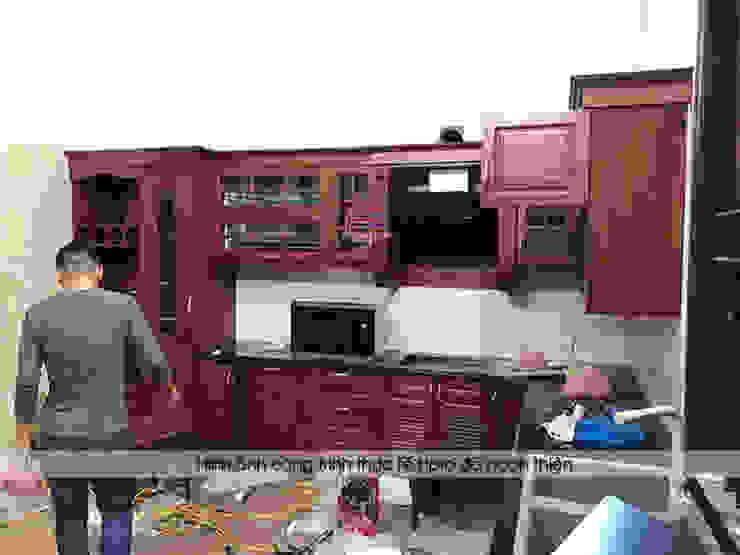 Quá trình lắp đặt và thi công bộ tủ bếp gỗ hương nhà cô Vân ở Thanh Hóa: hiện đại  by Nội thất Hpro, Hiện đại