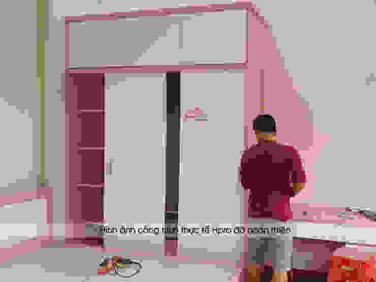 Thi công tủ quần áo gỗ công nghiệp An Cường trong phòng ngủ bé gái nhà anh Toản ở Lạng Sơn: hiện đại  by Nội thất Hpro, Hiện đại