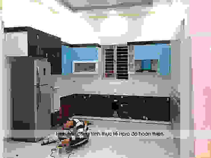 Ảnh thi công tủ bếp acrylic An Cường nhà chị Hiền ở Nam Định: hiện đại  by Nội thất Hpro, Hiện đại
