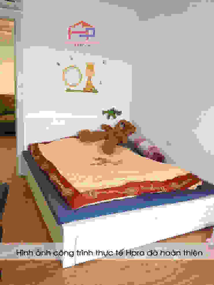 Ảnh thực tế giường ngủ của bé gỗ MDF sơn trắng nhà chị Quỳnh ở Ngoại Giao Đoàn: hiện đại  by Nội thất Hpro, Hiện đại