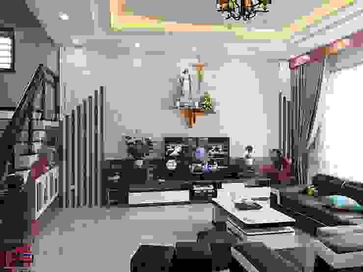 Ảnh thực tế nội thất phòng khách gỗ melamine nhà anh Năng ở Nam Định sau khi hoàn thành thi công: hiện đại  by Nội thất Hpro, Hiện đại