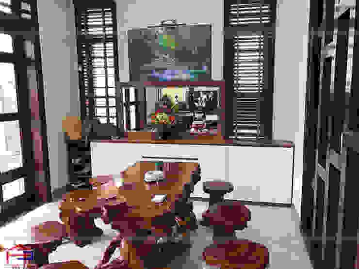 Ảnh thực tế tủ đựng giày gỗ melamine nhà anh Năng ở Nam Định: hiện đại  by Nội thất Hpro, Hiện đại