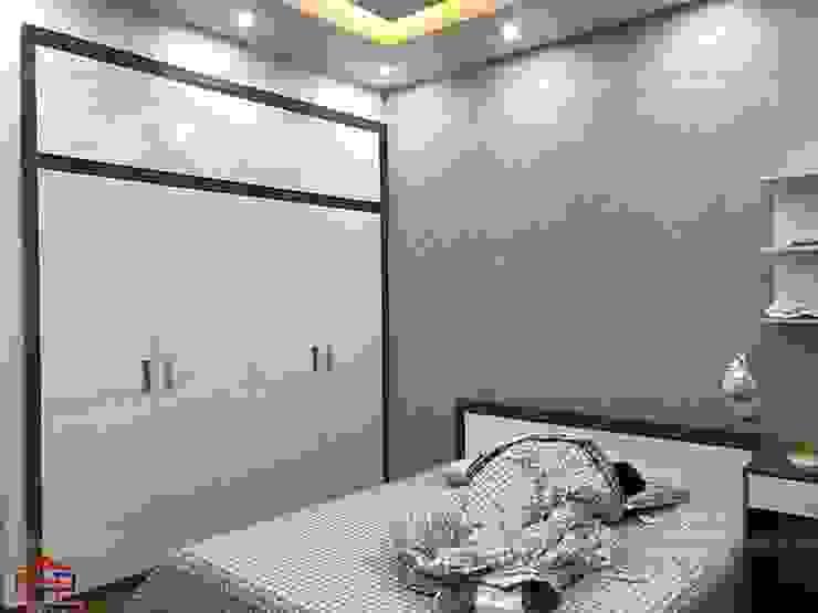 Ảnh thực tế nội thất phòng ngủ bé trai gỗ melamine nhà anh Năng ở Nam Định: hiện đại  by Nội thất Hpro, Hiện đại