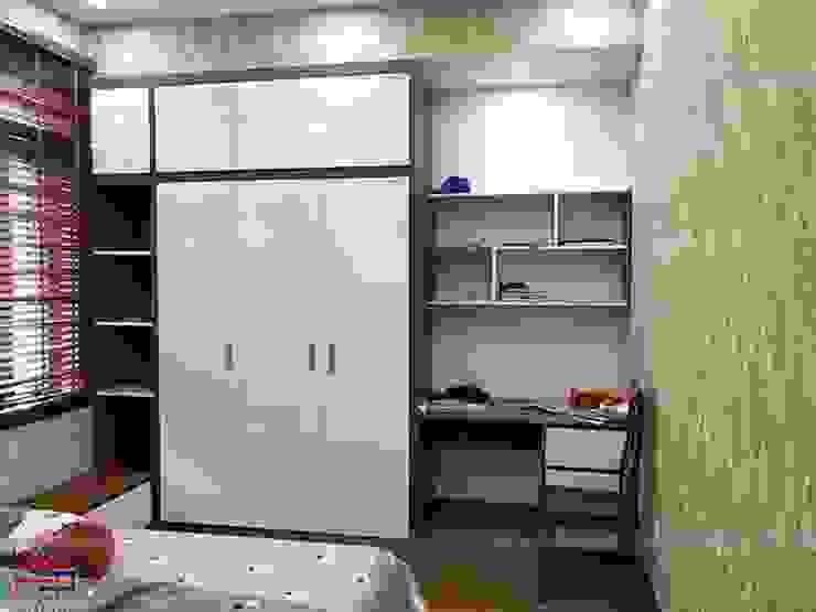 Ảnh thực tế tủ quần áo, kệ sách và bàn học gỗ melamine trong nội thất phòng ngủ bé gái nhà anh Năng ở Nam Định: hiện đại  by Nội thất Hpro, Hiện đại