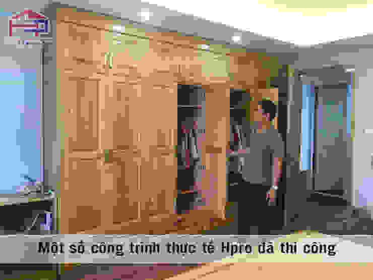 Ảnh thực tế tủ quần áo trong nội thất phòng ngủ của bé nhà anh Trọng ở Linh Đàm: Châu Á  by Nội thất Hpro, Châu Á